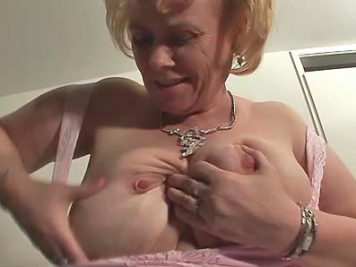 Granny plays with her big tits and soft wet cunt