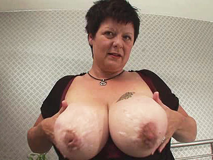 Fat granny plays with her huge tits n shaven pussy
